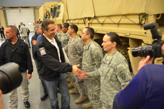 New York Governor Andrew Cuomo greets members of the New York Army National Guard's 369th Sustainment Brigade, during a visit to the Farmingdale Armed Forces Reserve Center in Farmingdale, N.Y., Oct. 29, 2012. The governor inspected Guard troops pre-positioned to respond to Hurricane Sandy as the storm rolled into New York