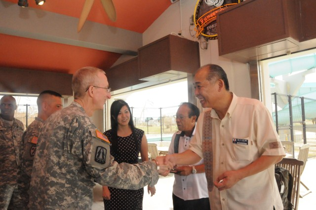 Eijun Ikehara, Deputy Mayor for the village of Yomitan, thanks Maj. Gen. James Walton, Commander, 311th Signal Command (Theater), for the Soldiers and Civilians of the 58th Signal Battalion's long standing volunteerism and community involvement on the island of Okinawa.
