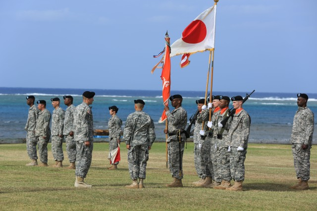 Col. Scott Baer, Commander, 516th Signal Brigade, 58th Commander Lt. Col. Eulys Shell and Command Sgt. Maj. Andrew Wynn prepare to case the battalion colors during the unit's inactivation ceremony at Torii Beach landing zone, Okinawa, Oct. 12.