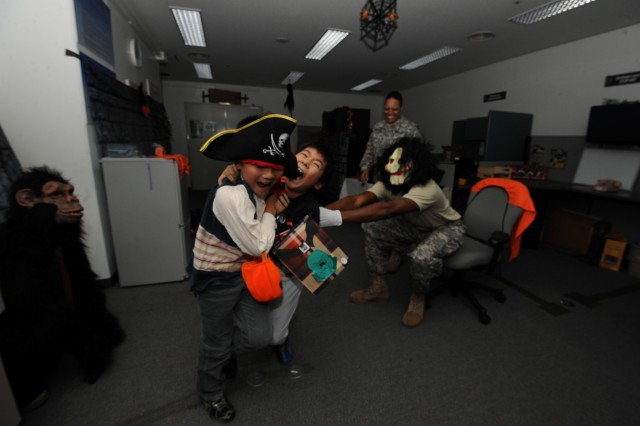 The children from LCA Kokusai Elementary School are scared of the masked soldiers in the haunted room set in the one of the offices of 35th CSSB headquarters building during the Friendship Halloween event.