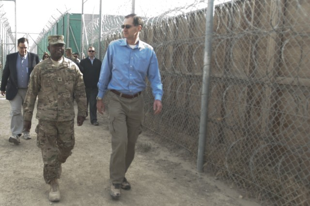 """CAMP SABALU-HARRISON, Afghanistan """" Brig. Gen. Phillip Churn, commanding general of Task Force Titan, speaks with Honorable James Miller, Under Secretary of Defense for Policy, during a tour of the Detention Facility in Parwan, Oct. 26, 2012. Churn led Miller on a tour to show the improvements and progress at the DFIP since Miller's last visit in March. (Department of Defense photo by U.S. Army Sgt. Katie D. Summerhill) (121026-A-JE610-138)"""