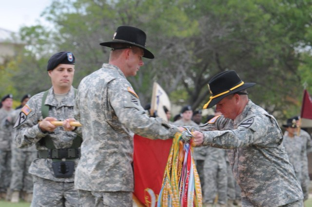 FORT HOOD, Texas--Lt. Col. William Johnson (left), commander of 5th Battalion, 82nd Field Artillery Regiment, 4th Brigade Combat Team, 1st Cavalry Division, and Command Sgt. Maj. Lawrence Maynard (right), the battalion's senior enlisted advisor, case their battalion colors during the brigade's color casing ceremony on Cooper Field Oct. 26 here.
