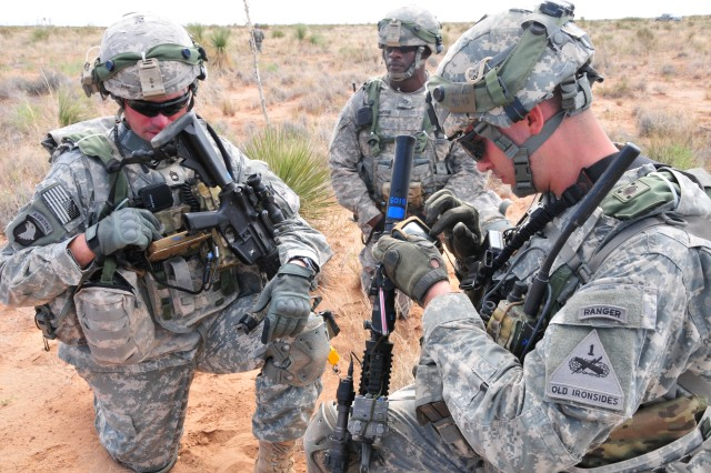 Soldiers from 1st Battalion, 35th Armored Regiment, 2nd Brigade, 1st Armored Division, integrate Nett Warrior into their training during the Network Integration Evaluation 13.1 at Dona Ana Range, N.M.