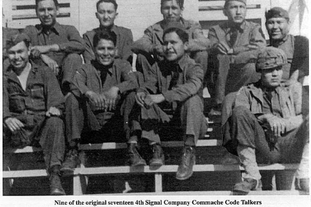 Nine of the original 17 4th Signal Company Comanche Code Talkers. Front row, from left: Forrest Kassanavoid, Charles Chibitty, Larry Saupitty and Roderick Red Elk. Rear row, from left: Edward Nahquaddy, Haddon Codynah, Ralph Wahnee, Willis Yackeshi and Perry Noyobad.