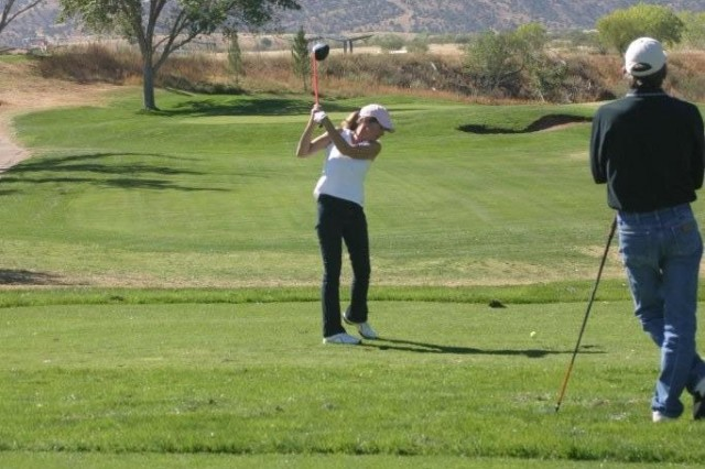 Sherry Arriaga, a local Sierra Vista resident, takes a practice swing at Hole 14. The Mountain View Golf Course is open to the public.