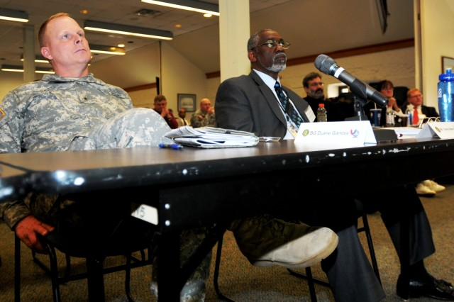 Brig. Gen. Duane A. Gamble, deputy commanding general, and Tommy L. Marks, executive director, LOGCAP, both of the Army Sustainment Command, listen during a presentation Oct. 30 at the Baylor Conference Room, Building 103, Rock Island Arsenal, Ill. They, along with about 80 others, attended a three-day gathering titled Operational Contract Support/Logistics Worldwide Requirements Meeting. (Photo by Jon Connor, ASC Public Affairs)