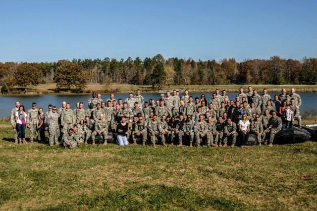 """FORT CAMPBELL, KY """"The seven combat engineer teams, their sponsors and their family members celebrates pose for a group photo after the teams completed their final event in the Fort Campbell Sapper Stakes 2012 held at the post's Demolition Range 39 and Training Area 44, Oct. 23-24. The Sapper Stakes 2012 was a competition between seven combat engineers teams stationed at Fort Campbell and throughout the surrounding region, went head to head against each other testing their physical fitness, basic Soldiering skills and of course their 12B Military Occupational Specialty specific skills. Strike Team 1 finished first overall in the competition."""