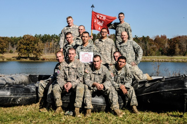 """FORT CAMPBELL, KY """" The combat engineers of Strike Team 1 from Company A, 2nd Brigade Special Troops Battalion, 2nd Brigade Combat Team, 101st Airborne Division (Air Assault), pose for a group photo after the team completed their final event in the Fort Campbell Sapper Stakes 2012 held at the post's Demolition Range 39 and Training Area 44, Oct. 23-24. The Sapper Stakes 2012 was a competition between seven combat engineers teams stationed at Fort Campbell and throughout the surrounding region, went head to head against each other testing their physical fitness, basic Soldiering skills and of course their 12B Military Occupational Specialty specific skills. Strike Team 1 finished first overall in the competition."""