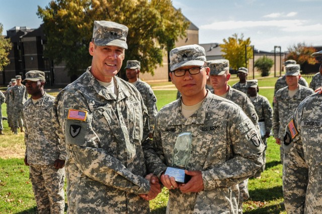 """FORT CAMPBELL, KY """" Maj. Gen. John R. """"Jack"""" O'Connor, Maj. Gen. John R. """"Jack"""" O'Connor, FORSCOM Deputy Chief of Staff, G-4, awards Sgt. Koogchan Hwan, a Soldier chef from Company D, 1st Squadron, 75th Cavalry Regiment, 2nd Brigade Combat Team, 101st Airborne Division (Air Assault), with the 2012 Outstanding Performer Award during a presentation ceremony for the Forces Command Level 45th Annual Phillip A. Connelly Award, held outside of the Strike Dining Facility, Oct. 24. The 101st's 2nd BCT, known as the Strike Brigade, won in the category for Active Army Field Kitchen-Field Feeding Operations, during the Connelly evaluation phase conducted earlier this summer; which tested Team Strike's ability to establish a field kitchen and while providing effective over-watch."""