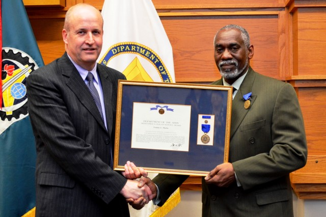 D. Scott Welker, deputy to the commander, Army Sustainment Command, congratulates Tommy L. Marks, then executive director of LOGCAP, after Marks was awarded the Meritorious Civilian Service Award Oct. 31 for his accomplishments from 2007 to 2012 with ASC. Marks' last day with ASC was Nov. 1 and he will now move to Washington, D.C., for his new position with the Department of the Army headquarters -- executive director for Acquisition Services, Office of the Deputy Assistant Secretary of the Army for Procurement. The MCSA is the second highest award and medal provided to civilian employees within agencies of the U.S. federal government. (Photo by Liz Adolphi, ASC Public Affairs)