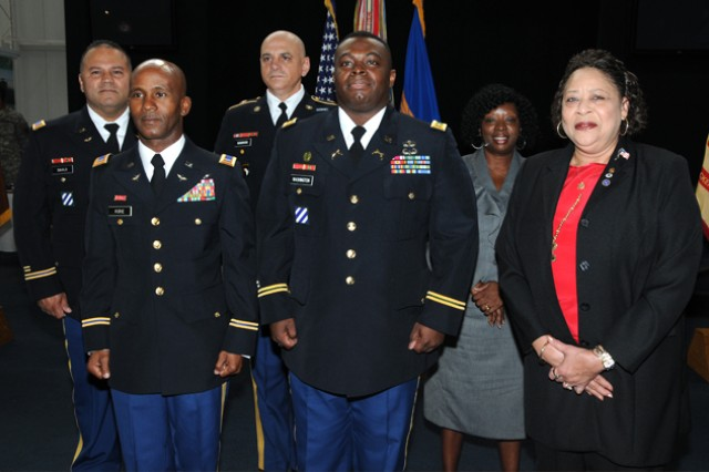 Retirees CW4 Tony Davila, CW4 Reginald L. Rorie, Sgt. Maj. John P. Hendricks Jr., Maj. Henry H. Washington III, Lola M. Smith and Maryian E. Llopis just before the post quarterly retirement ceremony Oct. 26 at the U.S. Army Museum.
