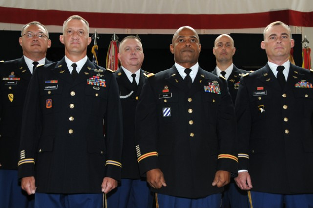 Retirees Col. Jimmy L. Meacham, CW4 John A. Cappadoro, 1st Sgt. Albert E. Kaufmann, CW4 Robert M. Irvin, CW3 Michael J. Christianson and CW4 Stanley A. Turnage just before the post quarterly retirement ceremony Oct. 26 at the U.S. Army Museum.