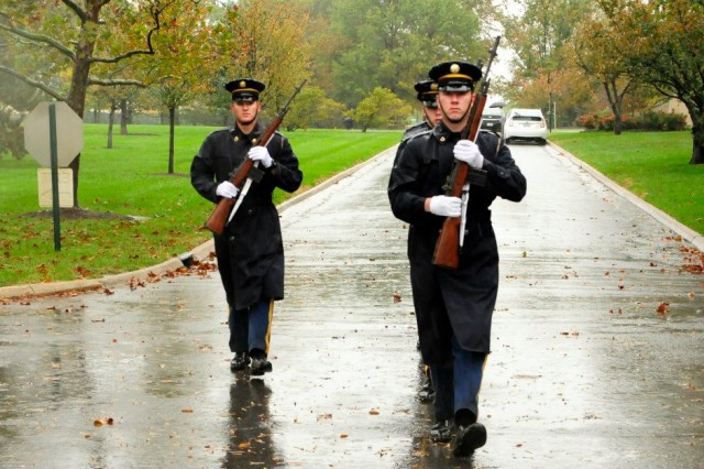 A Firing Party from Delta Company, 3d U.S. Infantry Regiment (The Old Guard), leaves the columbarium area after conducting a funeral for a veteran at Arlington National Cemetery, Va., Oct. 29, 2012. Even with Hurricane Sandy bearing down on the Eastern Seaboard, the Old Guard remained committed to honoring the nation's veterans.