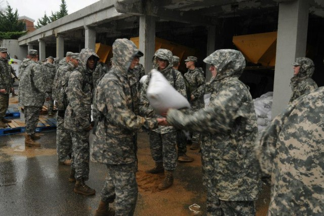 Soldiers from the 3d U.S. Infantry Regiment (The Old Guard), move sand bags onto pallets at Joint Base Myer-Henderson Hall, Va., Oct. 29, 2012. The regiment did all it could to help out the people of the area as Hurricane Sandy approached the Eastern Seaboard.