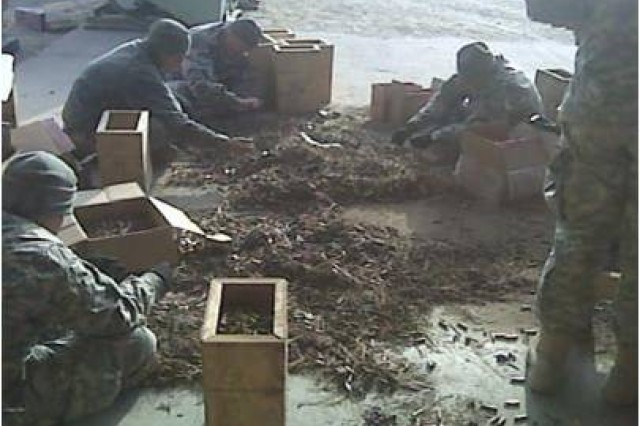 After a training event, Soldiers sort through and pack excess ammunition to be stored or shipped to another Ammunition Supply Point.
