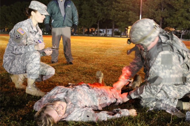 Sgt. Sarah Thiel, Kenner Army Health Clinic medic evaluates a Best Warrior competitor during the Department of the Army Solider and Noncommissioned Officer of the Year Best Warrior Competition event. Thirteen KAHC medics supported the casulaty evaluation event, Oct. 17.