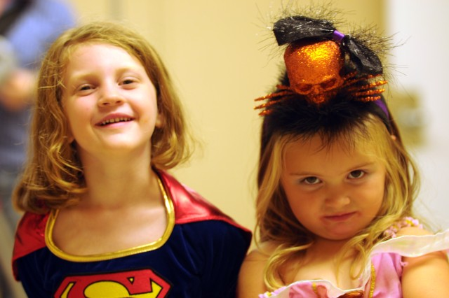 Saskia Dorf, left, dressed as Supergirl, and Kinsley Whalen, dressed as Cinderella, enjoy each other's company during the 5th Armored Brigade's Halloween Spooktacular held Oct. 24 at Fort Bliss, Texas. (Photo by Capt. John A. Brimley, 5th Armored Brigade, Division West, Public Affairs)