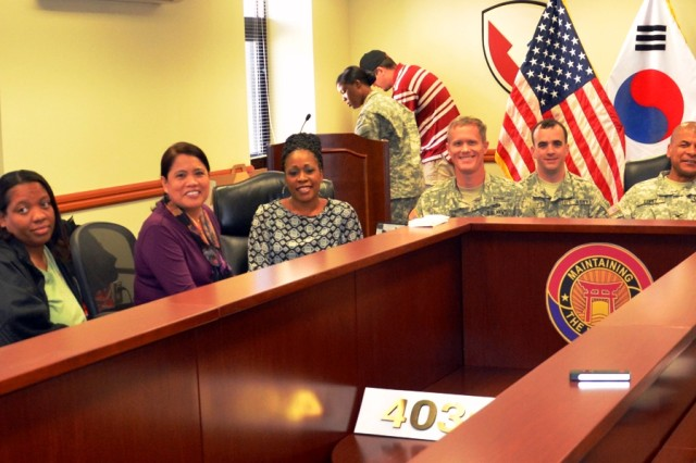 Shown are some attendees at the first 403rd AFSB's FRG Steering Committee meeting Oct. 26 attended by newly acquired Logistics Readiness Centers via a video teleconference from Korea and Japan. Attendees shown are, from left, Yong Mitchell; Sherry Gillyard; Regina Strong; Marianne Lopez; Wonda Speights; Lt. Col. Gary Cregan; Maj. Timothy Barrett; Col. Michael Lopez, 403rd AFSB commander; Command Sgt. Maj. Dexter Speights; James Pierce; and Marlu Villarosa. (Photo by Pfc. Kim Joon Hyung, 403rd AFSB)