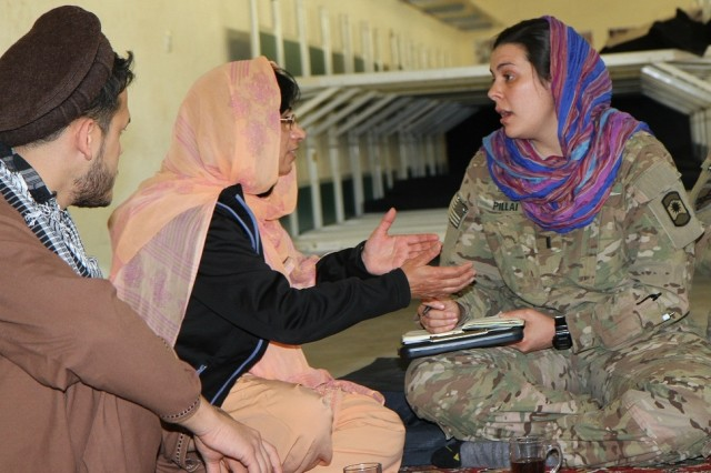 Foreign language speakers role play as local Afghan natives as 1st Lt. Cristina Pillai, team leader with Company D, 457th Civil Affairs Battalion, 361st Civil Affairs Brigade, 7th Civil Support Command, listens and takes notes