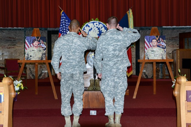 Vicenza Military Community Soldiers render final respects to Sgt. 1st Class Daniel T. Metcalfe civilian law enforcement adjunct Kevin O'Rourke at a memorial ceremony Nov. 1, 2012, at the Caserma Ederle post chapel in Vicenza, Italy.