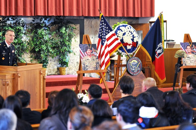 Chaplain (Lt. Col.) David Hall addresses surviving family members and mourners of the Vicenza Military Community at a memorial ceremony for Sgt. 1st Class Daniel T. Metcalfe and civilian law enforcement adjunct Kevin O'Rourke at the Caserma Ederle post chapel in Vicenza, Italy, Nov. 1, 2012.
