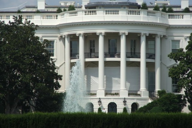 This is a close-up view of the United States White House. A fountain cools the sultry day.