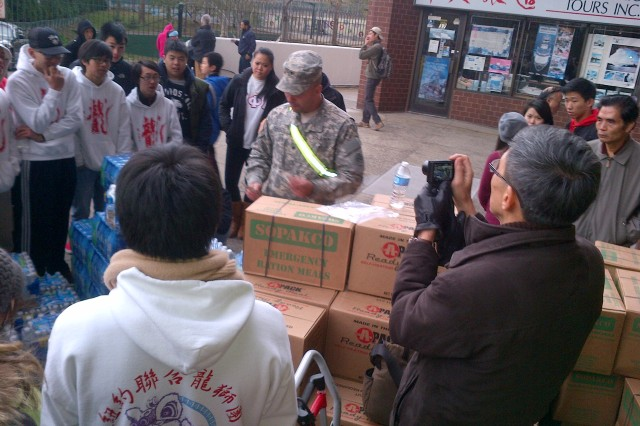 New York Army National Guard Spc. Eric Ramos, a member of the 1st Battalion 69th Infantry, provides a class on how to use the heater in Federal Emergency Management Agency emergency rations to volunteers at Confucius Plaza in New York City. New York National Guard delivery and distribution of food and water at this one location services two buildings (44 stories and 22 stories) with a population of more than 3,000 people. The residents are non-Eglish speaking and the videos and presentation will assist volunteers with safety and use as they conduct health and wellness checks daily.