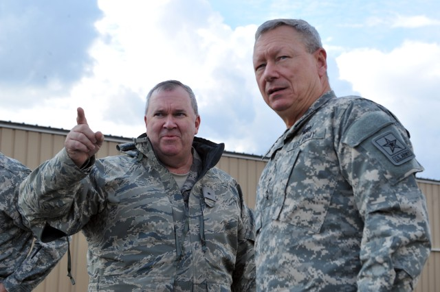 Air Force Brig. Gen. Michael Cunniff, the adjutant general of the New Jersey National Guard, briefs Gen. Frank Grass, the chief of the National Guard Bureau and other National Guard senior leaders visiting areas impacted by Hurricane Sandy in New Jersey and New York and Guard members supporting recovery operations, Nov. 2, 2012.  This image was acquired on a flight line where headgear is prohibited.