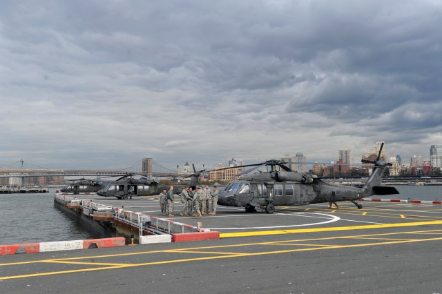 National Guard UH-60 Black Hawk helicopters are seen at the Downtown Manhattan Heliport as Army Gen. Frank Grass, the chief of the National Guard Bureau; Air Force Chief Master Sgt. Denise Jelinski-Hall and other National Guard senior leaders visit areas impacted by Hurricane Sandy in New Jersey and New York and Guard members supporting recovery operations, Nov. 2, 2012.