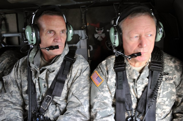 Gen. Frank Grass, the chief of the National Guard Bureau, is briefed by Maj. Gen. Patrick Murphy, the adjutant general of the New York National Guard, on Manhattan during a visit to areas impacted by Hurricane Sandy in New Jersey and New York and Guard members supporting recovery operations, Nov. 2, 2012.