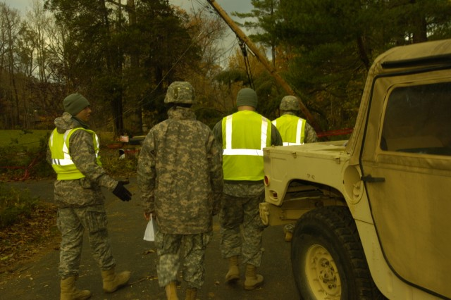 New York Army National Guard Soldiers from the 42nd Infantry Division move out on a mission to locate and mark downed utility lines, Nov. 3, 2012.  Almost 500 New York Army National Guard Soldiers have been dedicated to missions in Westchester and Rockland counties to work with utilities in restoring the power grid and on other missions in the wake of Hurricane Sandy. The Soldiers have been trained to locate and safely mark and isolate downed power lines.