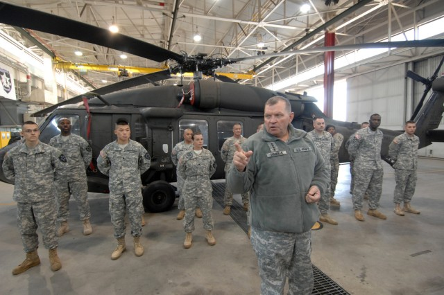 Gen. James D. Thurman, commander of United Nations Command, Combined Forces Command, and U.S. Forces Korea, center, speaks with Soldiers from the 2nd Battalion (Assault), 2nd Aviation Regiment during his visit to K-16 Airfield, Nov. 1. (U.S. Army photo by Cpl. Lee Hyokang)