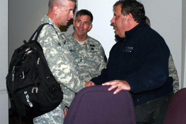"""TRENTON, New Jersey - Command Sgt. Maj. Robert Winzenried (left) and Lt. Gen. William B. Caldwell IV speak with Gov. Chris Christie of New Jersey at the Regional Operations and Intelligence Center at the State Police Headquarters here Nov. 3. The leaders spoke about the Department of Defense's partnership with the Federal Emergency Management Agency in the """"whole of government"""" response to Hurricane Sandy. Caldwell visited the site to meet with Col. Barrett Holmes to discuss the state's emerging needs, which may require Department of Defense assistance. Caldwell is the commanding general of U.S. Army North (Fifth Army) and senior commander, Fort Sam Houston and Camp Bullis, Texas. Winzenried is the senior enlisted leader for North American Aerospace Defense Command and United States Northern Command at Peterson Air Force Base, Colo. Holmes is the defense coordinating officer for Army North's Region IV Defense Coordinating Element. Also visiting the site were U.S. Air Force Brig. Gen. Michael Cunniff, New Jersey adjutant general, and Command Sgt. Maj. David Wood, U.S. Army North (Fifth Army). Army North is the Joint Force Land Component Command for U.S. Northern Command. (U.S. Army photo by Donald Manuszewski, Army North PAO)"""