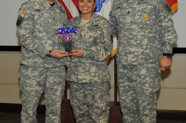 USAREC Commanding General Maj. Gen. David L. Mann and Command Sgt. Maj. Todd Moore present the Army Reserve NCO of the Year award to Sgt. 1st Class Mariela Richardson.