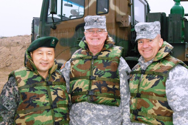 REPUBLIC OF KOREA - (Left to Right) Brig. Gen. Jong Kwan Park, Republic of Korea Army CFC Engineer; Brig. Gen. Douglas R. Satterfield, Deputy Commanding General, 412th Theater Engineer Command; and Col. Thomas Roth, Commander of 2nd Engineer Brigade-Alaska, part of a military observation team in the country's annual Hoguk exercises, are pictured here during the early morning hours of river assault training Oct. 27.