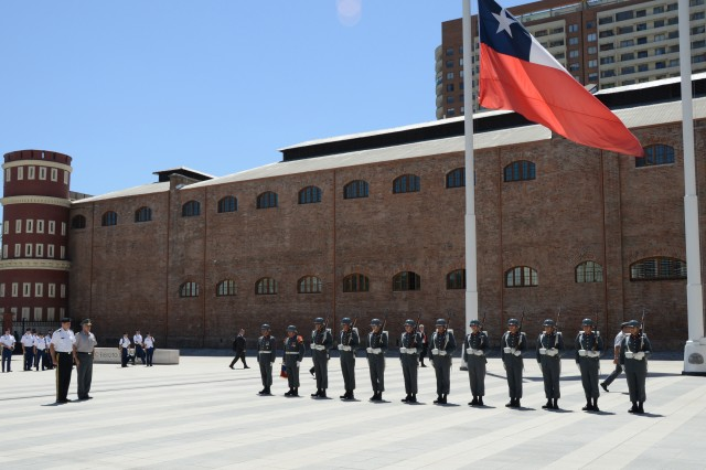 Maj. Gen. Frederick S. Rudesheim (left), the U.S. Army South commanding general, and Chilean Col. Javier Assadi, the Chilean foreign liaison officer to Army South, are greeted by a Chilean army honor guard upon arriving at the Edificio Ejercito Bicentenario (Chilean army headquarters) for the first day of the army-to-army staff talks between the U.S. and Chilean armies Nov. 5, 2012, in Santiago, Chile. The staff talks are scheduled to take place Nov. 5-7, and will serve as a bilateral forum for strategic-level discussion between respective armies. The engagements enhance army-to-army contacts and mutual understanding, providing the partner nation armies with insights concerning specific U.S. Army programs, areas of mutual interest, and assisting partner nation armies in areas of modernization or reform.