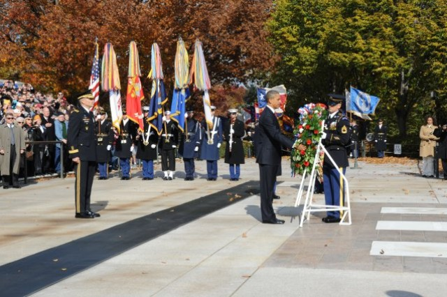 President Barack Obama lays a wreath at the Tomb of the Unknowns during the annual Veterans Day observance at Arlington National Cemetery in Arlington, Va., Nov. 11, 2011.