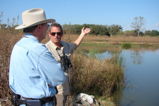 Dr. Gary O. Dick, of the U.S. Army Corps of Engineer's Lewisville Aquatic Ecosystem Research Facility in Texas, explains to a visitor during Saturday's tour of the Trinity Lower Chain of Wetlands how the system works to provide quality habitat while also reducing flood risk for Dallas citizens. The USACE Fort Worth District began construction of these wetlands in 2004 for the city of Dallas, and more are planned.