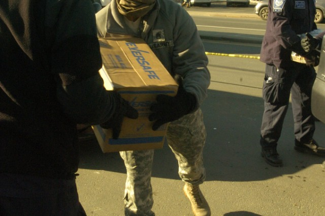 New York Army National Guardsmen distribute food, water and other supplies to civilians in need in the aftermath of Hurricane Sandy in Breezy Point, New York. New York Governor Andrew Cuomo mobilized more than 4,500 service members of New York's volunteer military forces, while National Guard Soldiers from four other states are also helping civilian authorities in recovery efforts in the aftermath of Sandy.