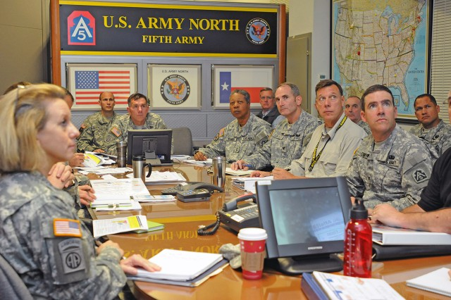 Lt. Gen. William Caldwell IV (center), commanding general, U.S. Army North (Fifth Army), listens as his staff briefs him at the Combined Operations and Integration Center conference room on the Department of Defense's ongoing response to Hurricane Sandy relief efforts.