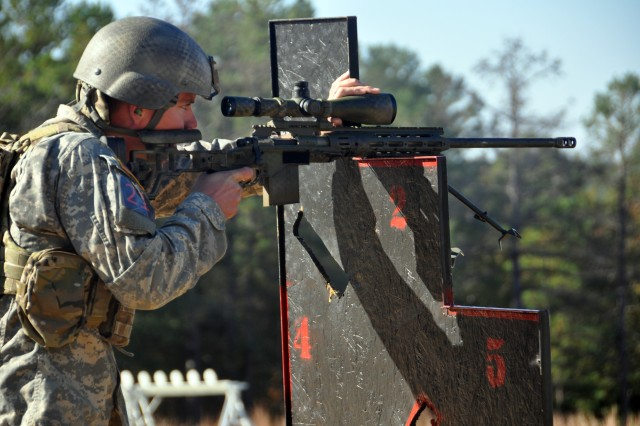 Spc. Tyler Payne, U.S. Army Marksmanship Unit, fires on a target during the 2012 International Sniper Competition, Nov. 5, 2012, at Burroughs Range at Fort Benning, Ga. Payne and his USAMU teammate Staff Sgt. Daniel Horner won the competition in their first attempt. Both Soldiers are members of the USMAU's Action Shooting team.