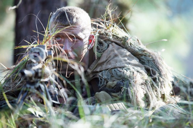 Staff Sgt. Mathew Fox, 3rd Armored Brigade Combat Team, waits to engage a target, Nov. 3, 2012, during the 12th annual International Sniper Competition, at Fort Benning, Ga.
