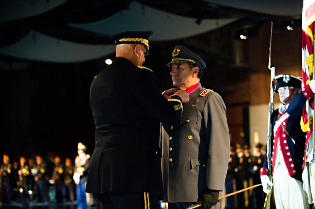 U.S. Army Chief of Staff Gen.. Raymond T. Odierno presents the Legion of Merit to Gen. Juan Miguel Fuente-Alba Poblete, Commander in Chief of the Chilean Army, during an arrival ceremony at Conmy Hall in Joint Base Myer-Henderson Hall, Va. Nov. 6, 2012. (U.S. Army Photo by Staff Sgt. Teddy Wade/Released)