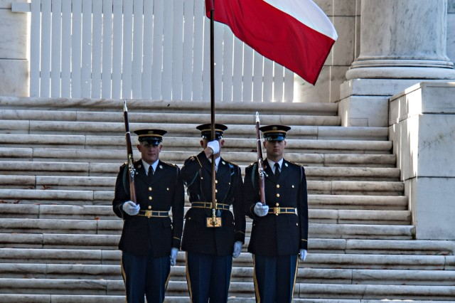 """U.S. Army Soldiers from the 3rd Infantry Regiment """"Old Guard"""", carry the Chilean flag during a wreath laying ceremony at the tomb of the Unknown Soldier with Gen. Juan Miguel Fuente-Alba Poblete, Commander in Chief of the Chilean Army, and Army Chief of Staff Gen.. Raymond T. Odierno in Arlington National Cemetery, Va. Nov. 6, 2012. (U.S. Army Photo by Staff Sgt. Teddy Wade/Released)"""