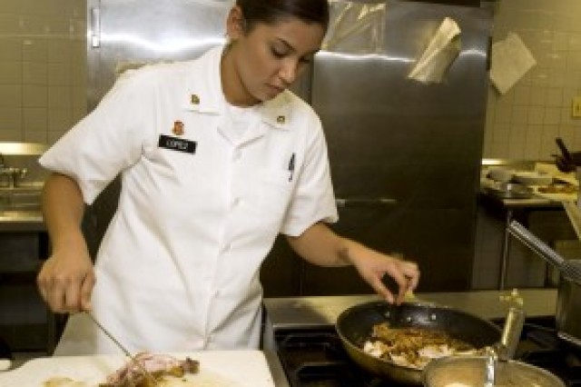 Spc. Stephany Lopez, assigned to the 25th Combat Aviation Brigade food service division, cooks a meal while competing for a spot on the U.S. Pacific Command Joint Culinary Arts Team Hawaii. In November 2012, the winners will be announced and will go on to compete in the 38th annual U.S. Army Culinary Arts Competition at Fort Lee, Va.