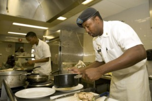 Spc. Omar Reeves, assigned to the 54th Combat Sustainment Support Battalion, begins to plate his meal while competing for a spot on the U.S. Pacific Command Joint Culinary Arts Team Hawaii. In November 2012, the winners will be announced and then compete in the 38th annual U.S. Army Culinary Arts Competition at Fort Lee, Va.