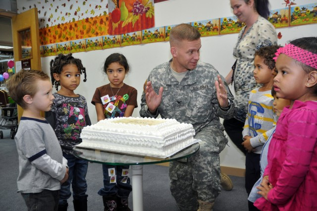 Col. Michael E. Masley, garrison commander for U.S. Army Garrison Yongsan, talks to kids before a cake cutting ceremony during the Thanksgiving Book Reading held at the Yongsan Library, Nov. 6. (U.S. Army photo by Cpl. Lee Hyokang)