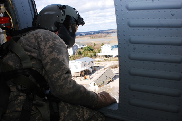 Sgt. Matthew J. Last, 3-10 General Support Aviation Battalion crew chief, observes the Rhode Island coastline, Nov. 1, 2012, when the 10th Combat Aviation Brigade transported Federal Emergency Management Agency Region II representatives on Black Hawks to assess damage.
