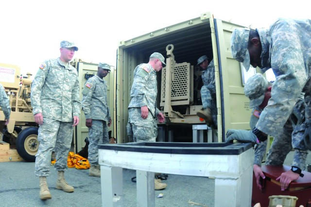 Soldiers of the 108th Quartermaster Company, 530th Combat Sustainment Support Battalion, 82nd Sustainment Brigade, prepare equipment for shipment Nov. 1 at the unit's motor pool.  The unit is currently located at a Joint Base McGuire-Dix-Lakehurst staging area awaiting orders to support Hurricane Sandy relief efforts.