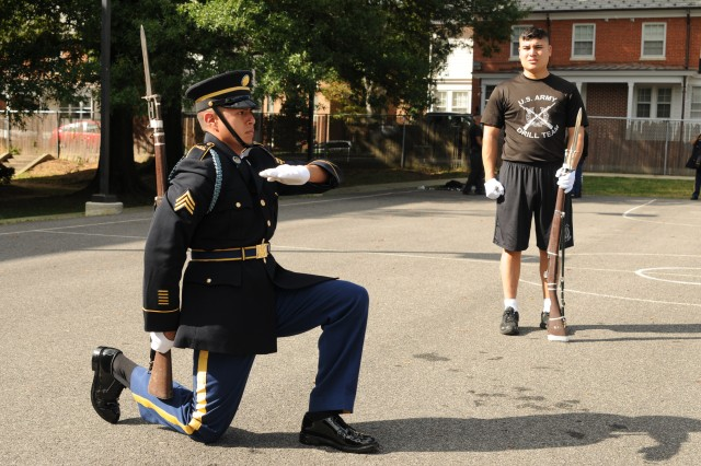 "Sgt. Mychael Begaye, infantryman, 3d U.S. Infantry Regiment (The Old Guard), tries out for the U.S. Army Drill Team [USADT] at Joint Base Myer "" Henderson Hall, Va. Soldiers who make the team can learn and hone their rifle drilling skills in the USADT and perform in many places across the globe. (U.S. Army photo by Sgt. Luisito Brooks)"